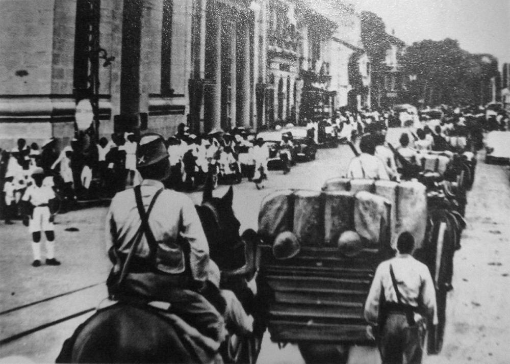 1200px-Japanese_troops_entering_Saigon_in_1941.jpg
